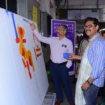 Mr. Milind Deouskar, Assistant Divisional Railway Manager painting canva...